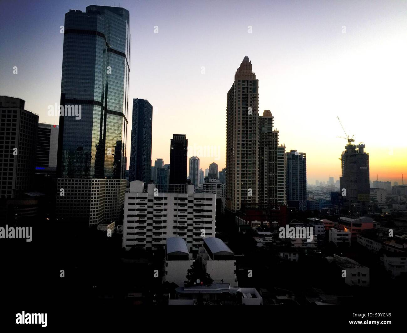 View of Bangkok's urban sprawl at dawn - Stock Image
