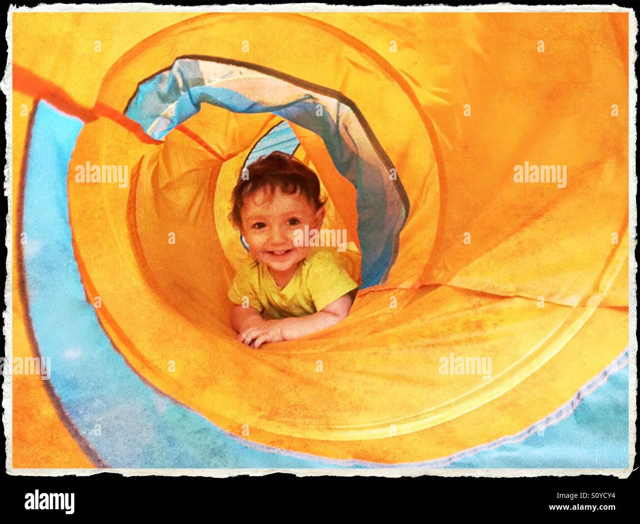 Cute happy child playing - Stock Image