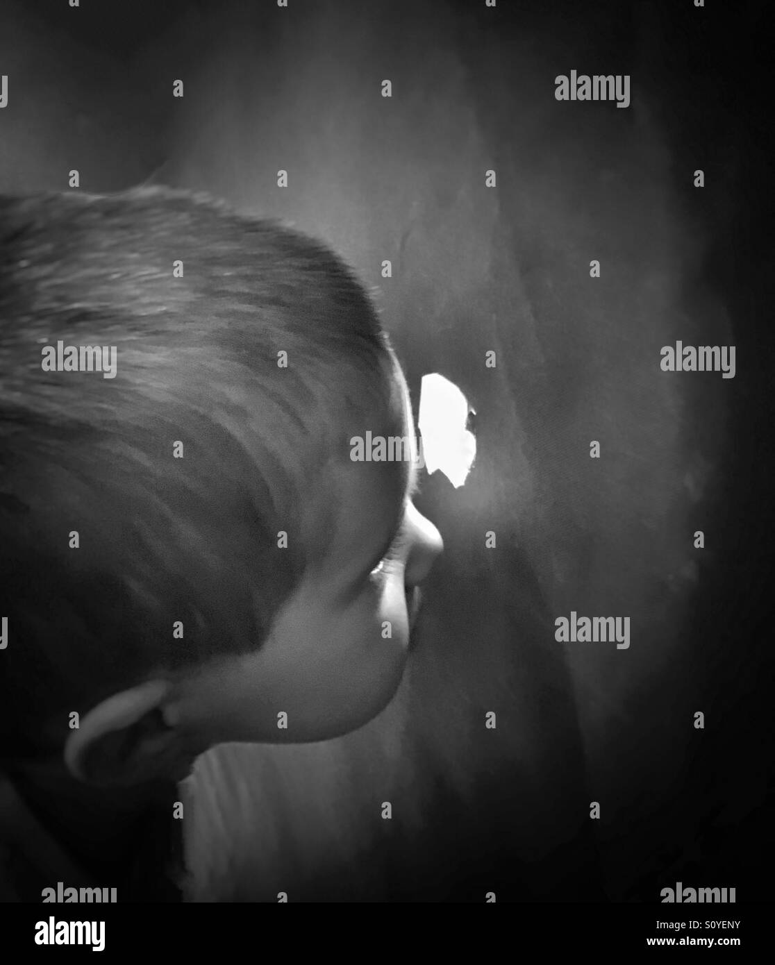 Peeking through the hole - Stock Image