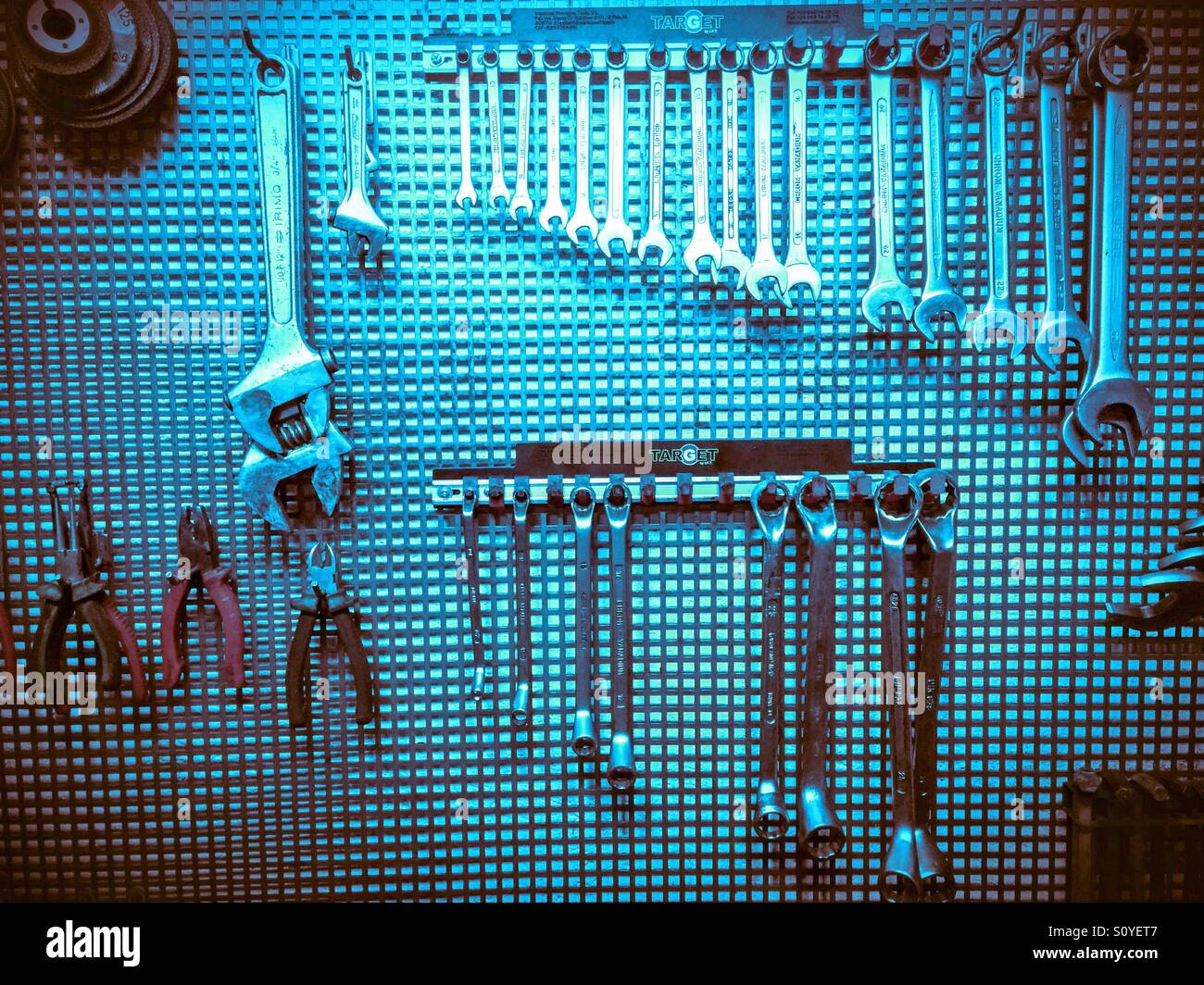 Assorted workshop tools on a pegboard. - Stock Image