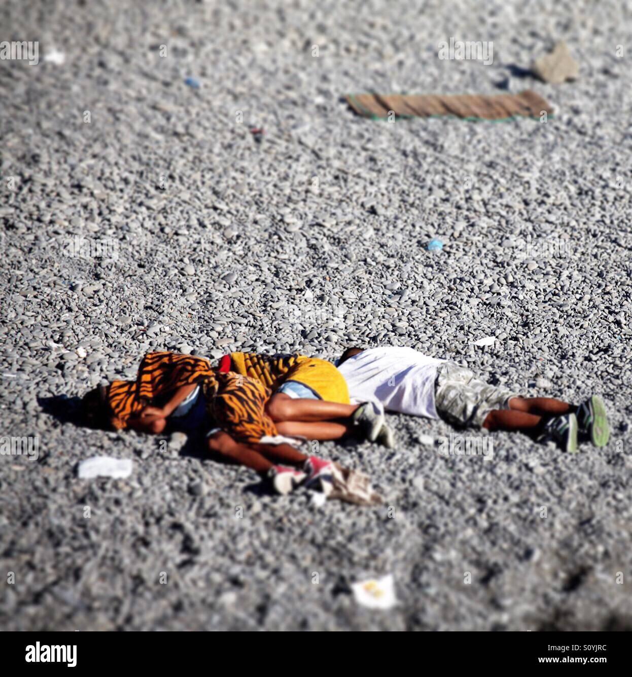 Sleep on the beach - Stock Image