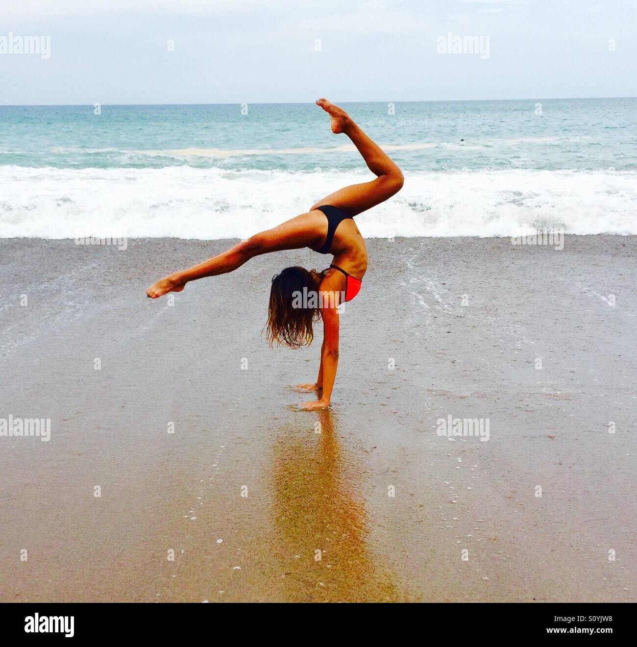 61def3bcff77bf Doing flips on the beach Stock Photo  310394148 - Alamy