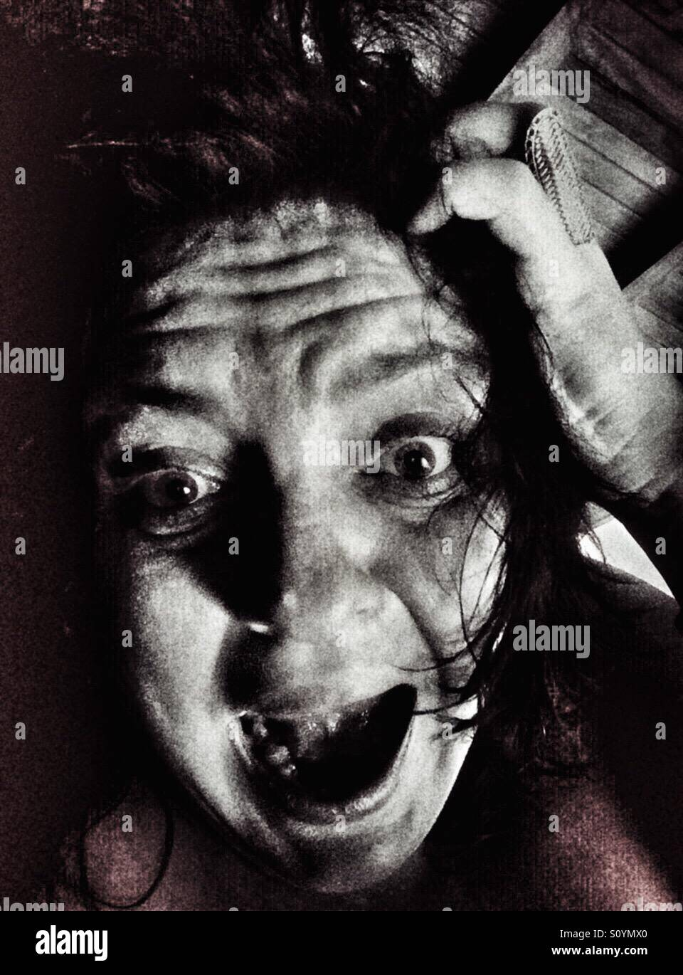 Scared woman - Stock Image