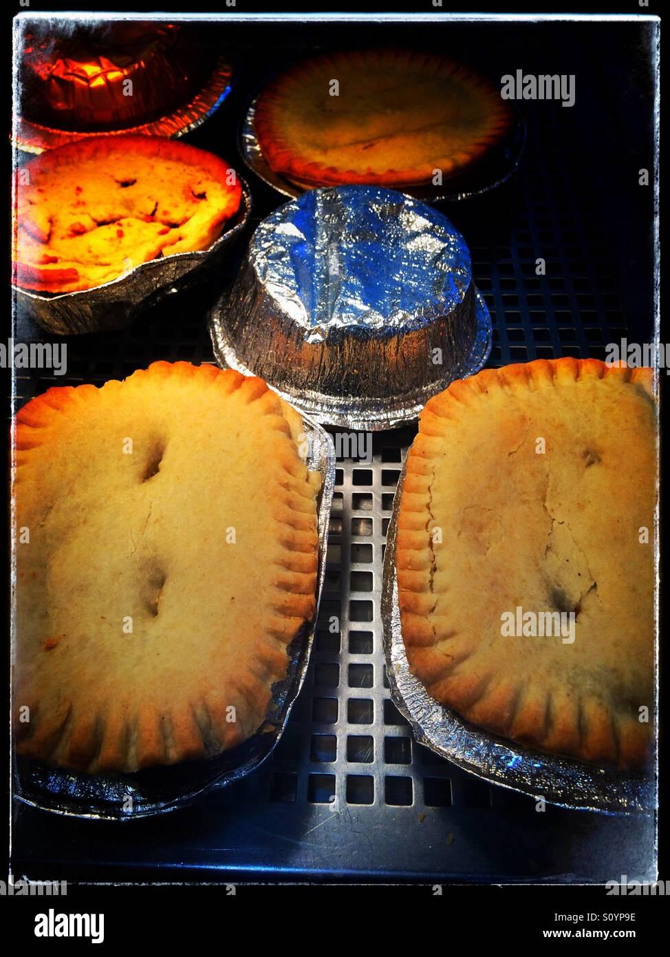 Pies keeping warm Stock Photo