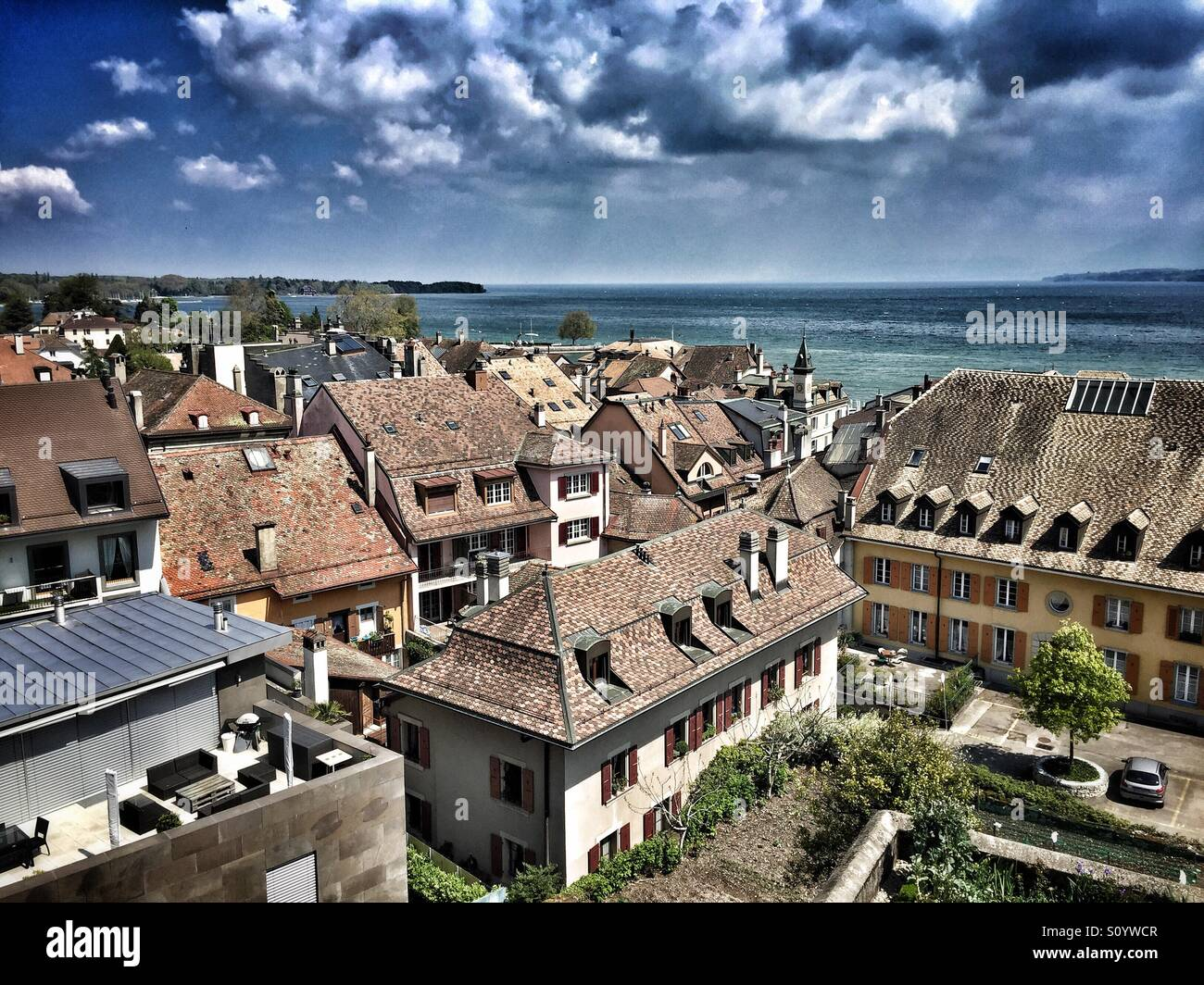Looking over the old town of Nyon to Lake Geneva and the Alps - Stock Image