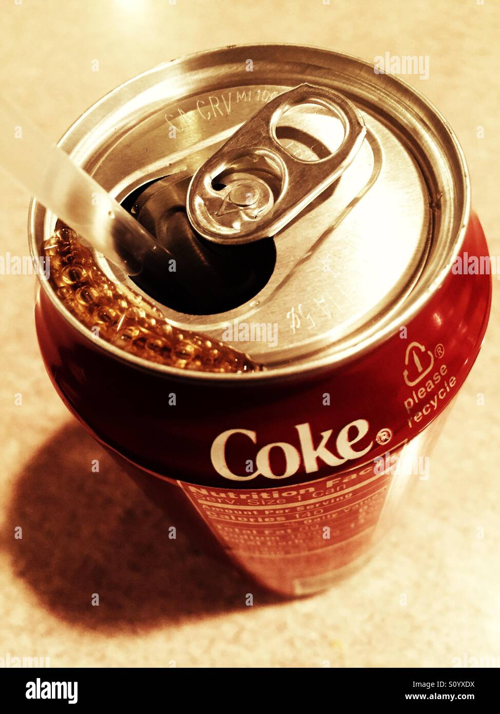 Coke can opened and shot from above - Stock Image