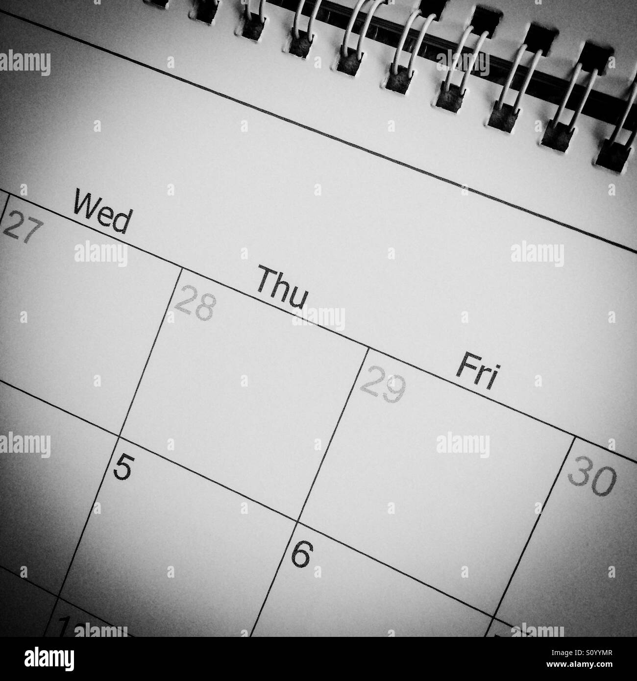 Close up view of a calendar with days and dates visible - Stock Image