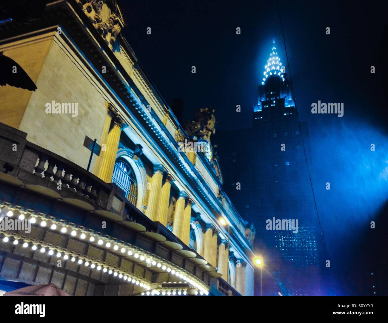 Grand Central Station and the Chrysler Building on a foggy rainy night Manhattan New York City vintage blue and - Stock Image