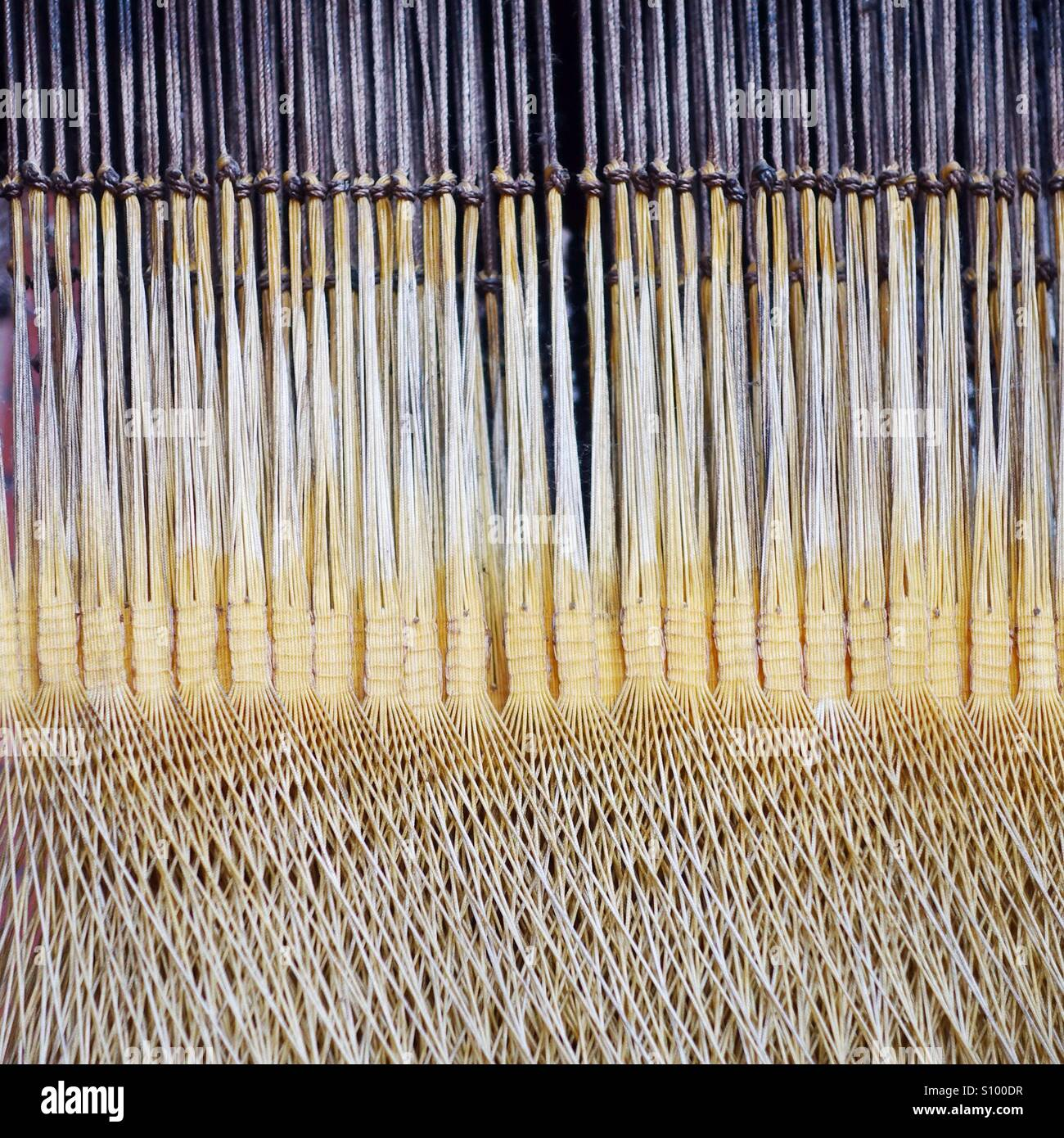 Close up of old weaving loom with waft and weft - Stock Image