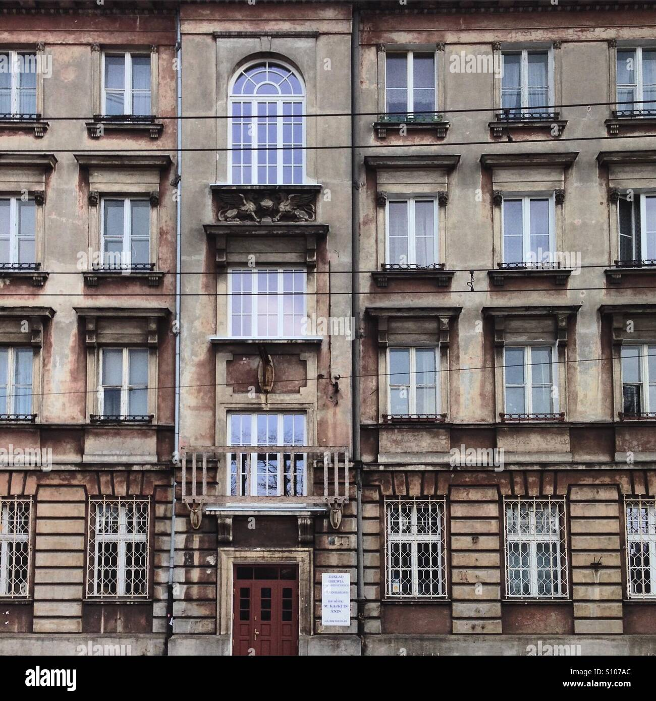 The facade of a building in Praga district of Warsaw - Stock Image