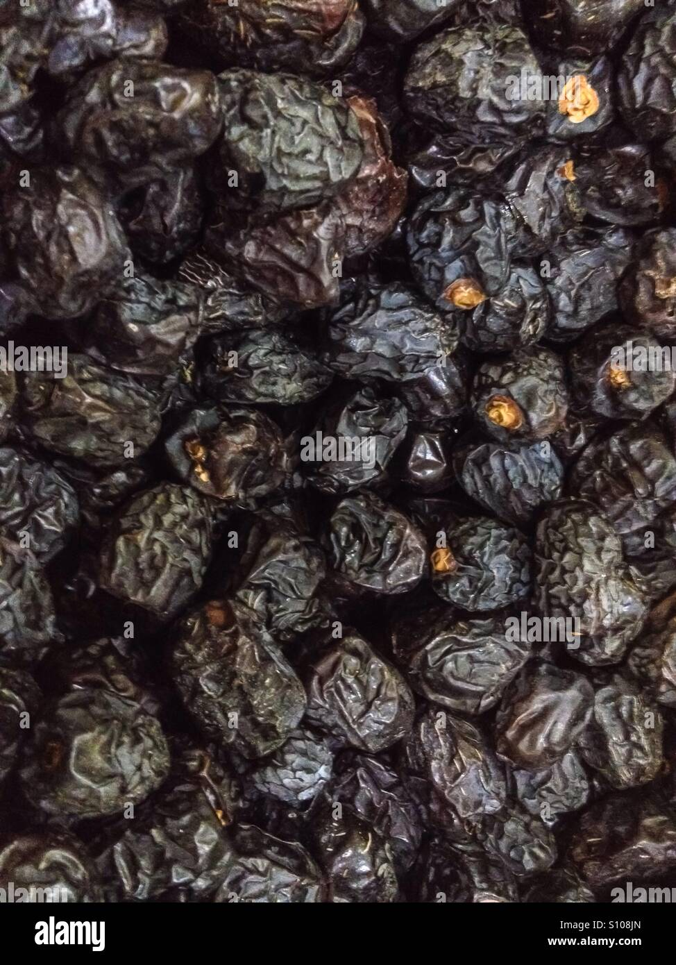 Ajwa dates or known as the Prophet's dates in reference to Prophet Muhammad where they are derived from the - Stock Image
