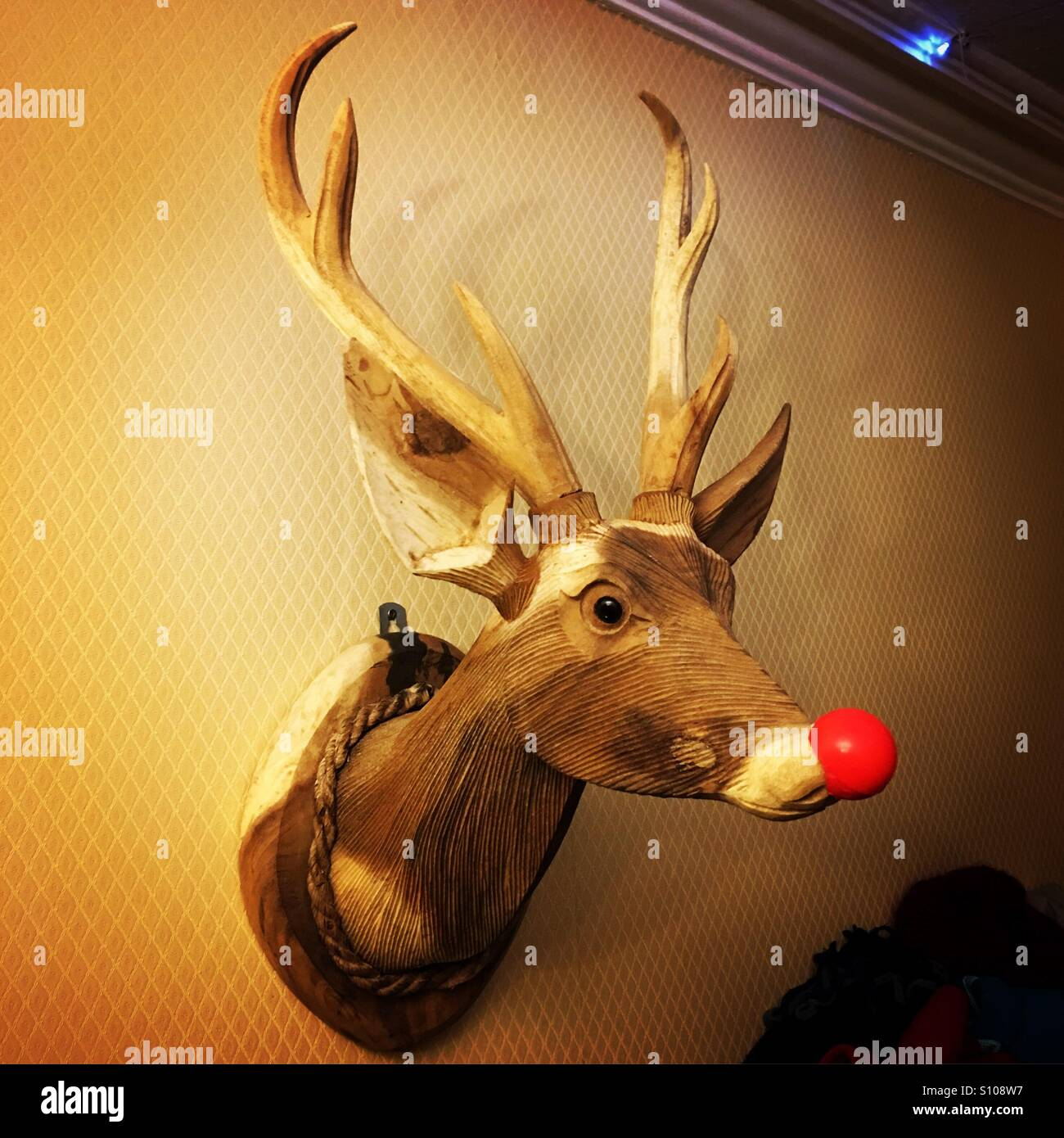 Wooden Rudolf the Red Nosed Reindeer mounted on wall Stock Photo ...