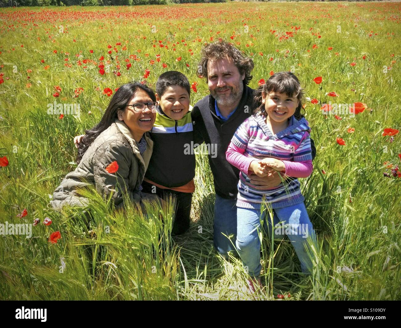 Interracial family. - Stock Image