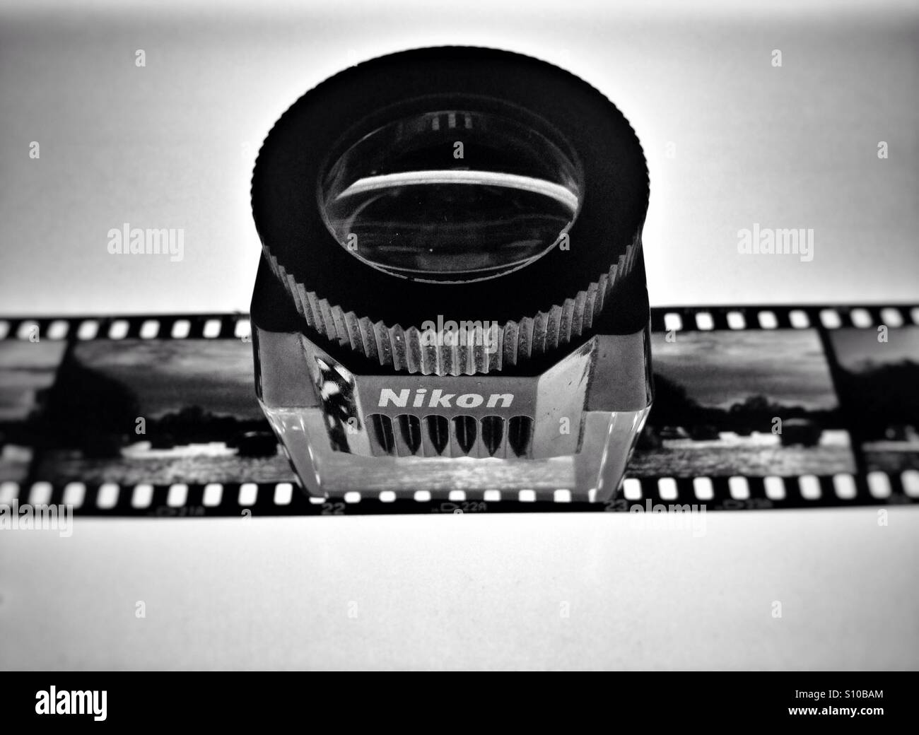 Nikon Lupe on light box to view 35mm transparency film - Stock Image