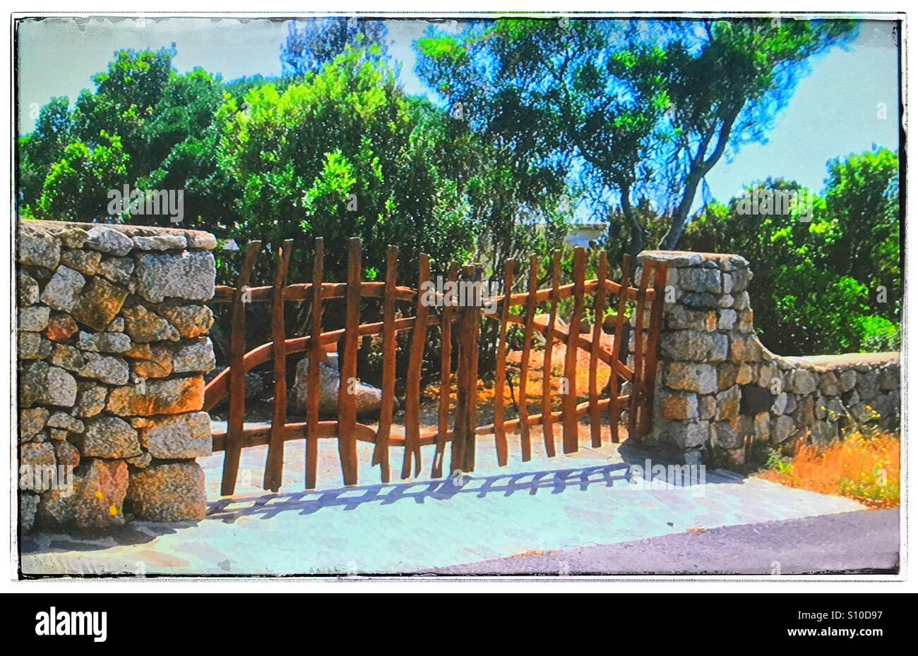 Wooden fence across private driveway - Stock Image