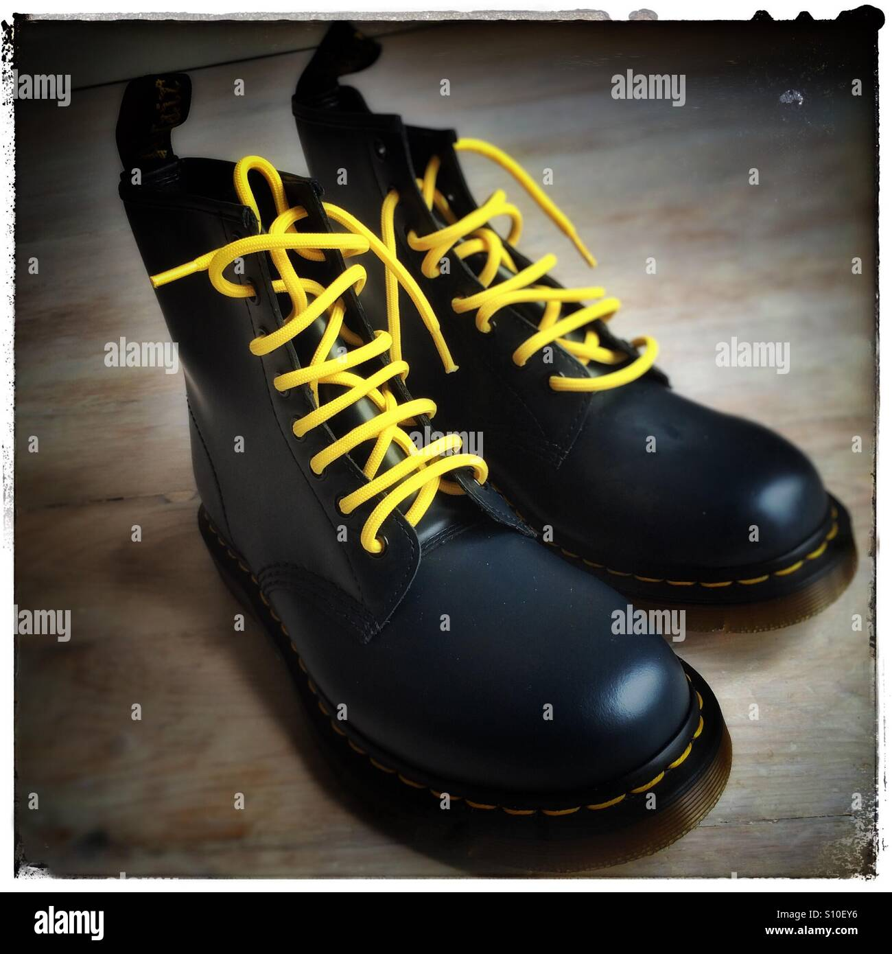 Dr Martens classic style boots in blue leather with yellow