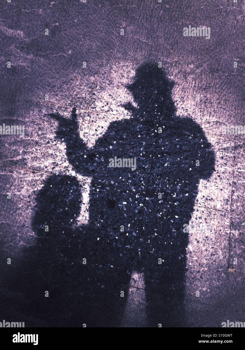 Gangster shadow on ground - Stock Image