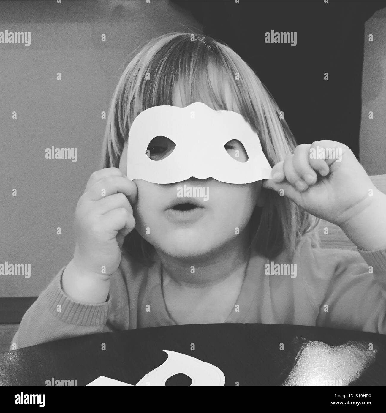 Toddler with mask - Stock Image