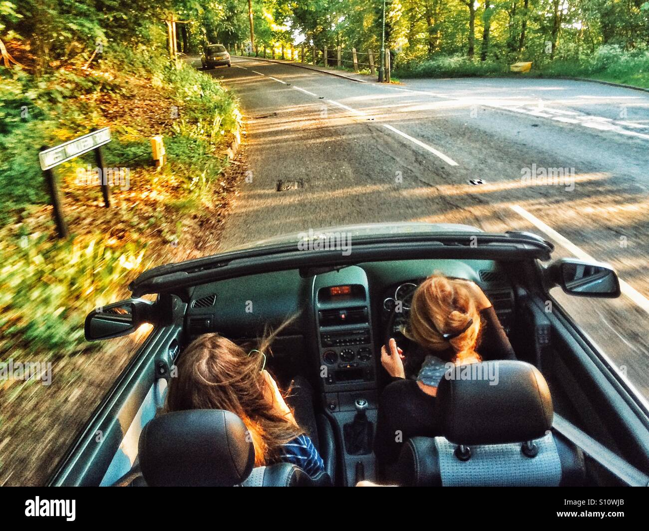 Soft top car along country road - Stock Image