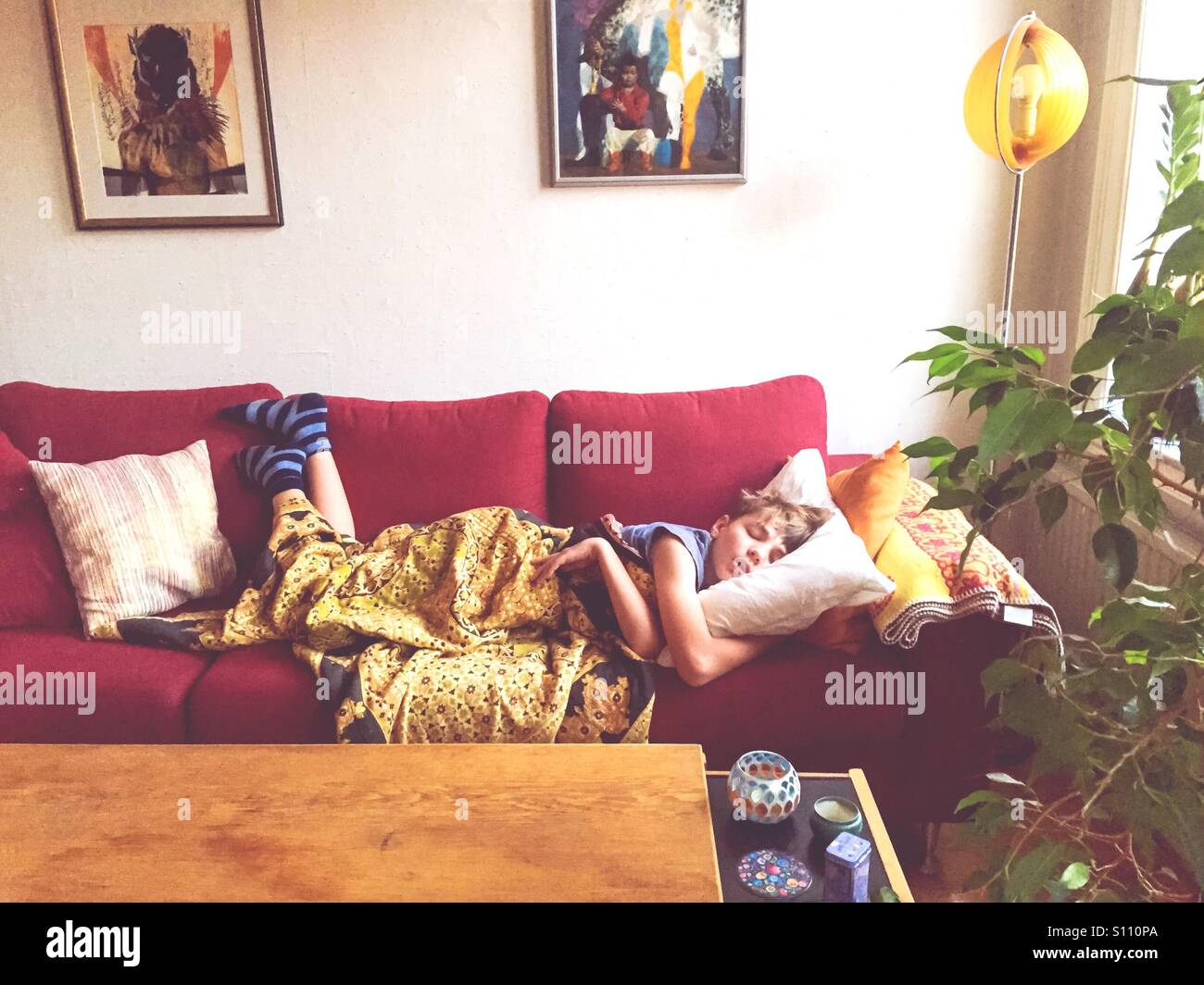Sleeping boy on the sofa - Stock Image