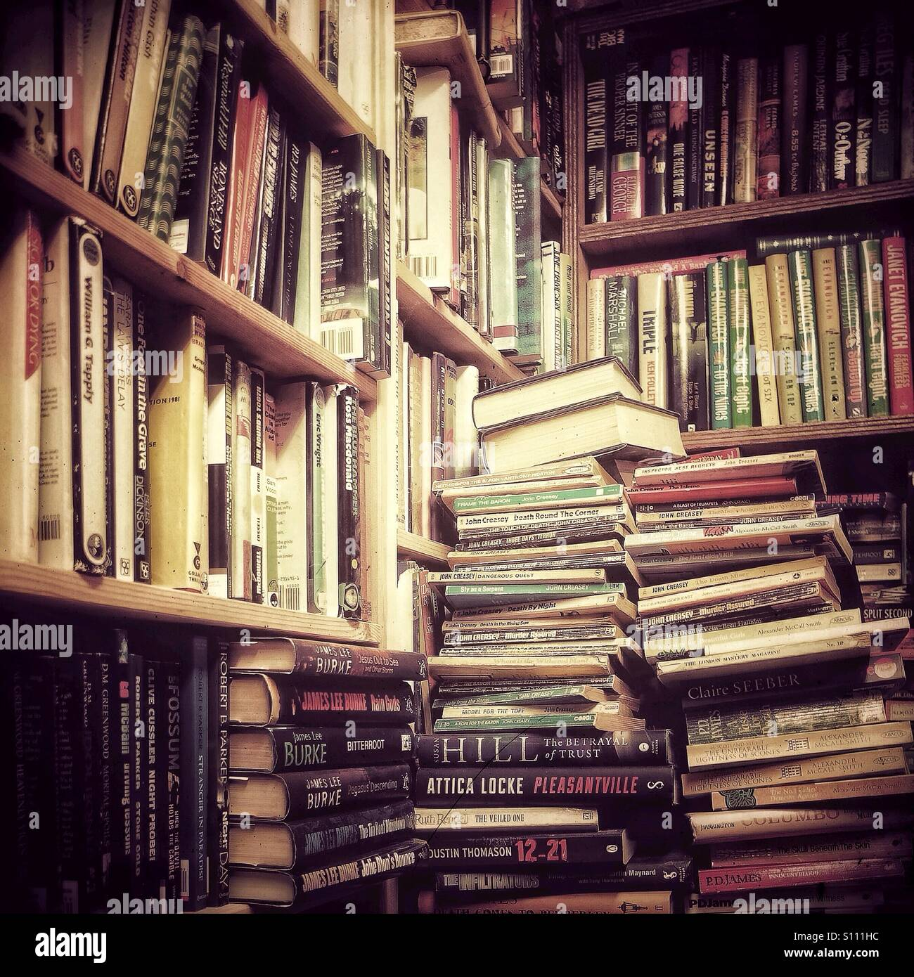 Piles of books in secondhand bookshop - Stock Image