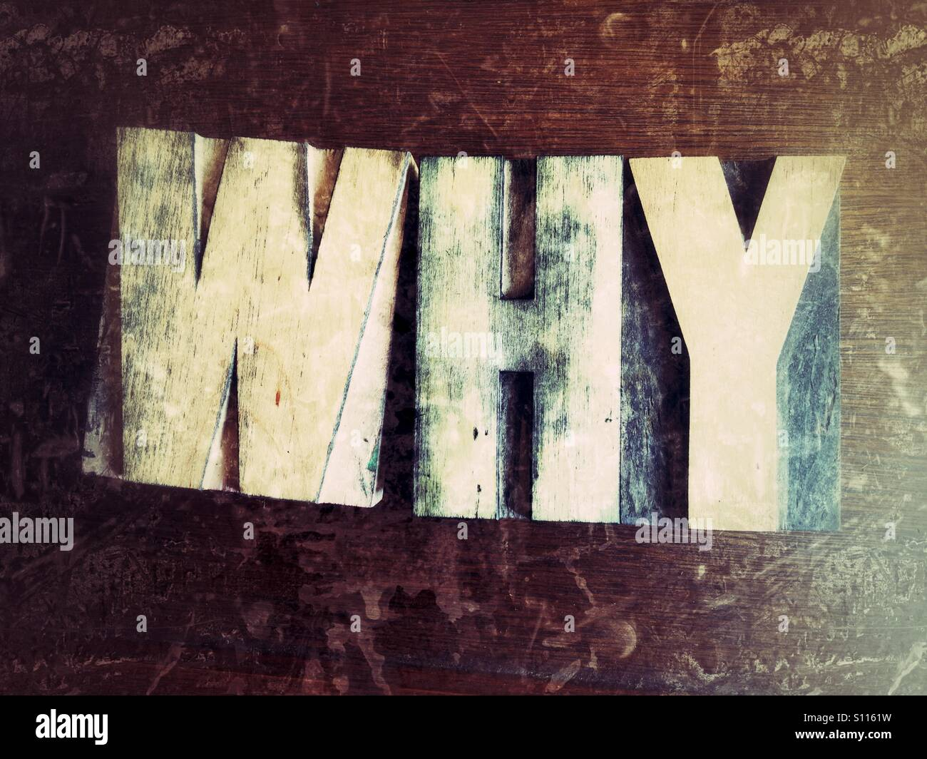 The word why in old wood type - Stock Image