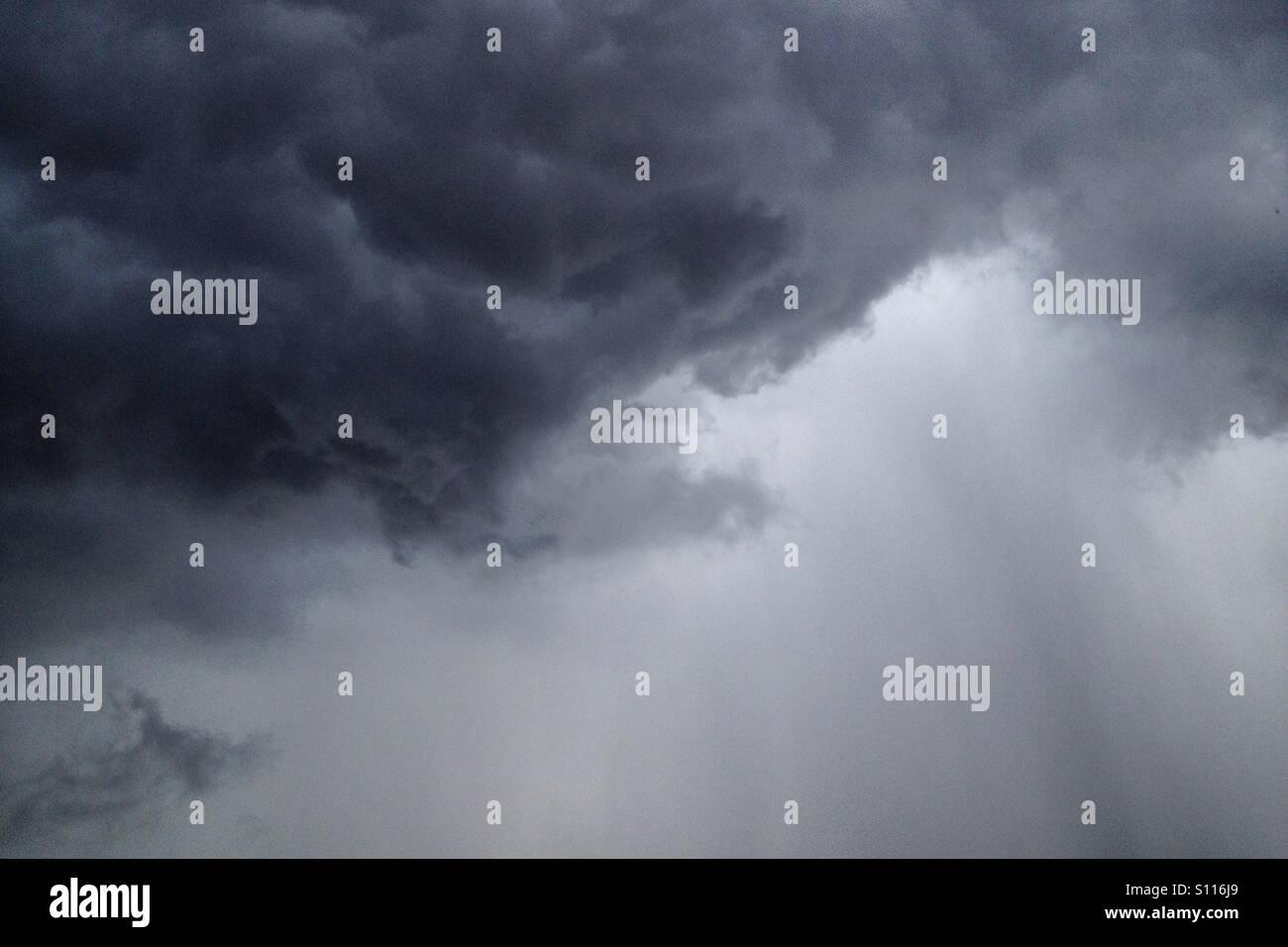 Dark stormy rain cloud. - Stock Image