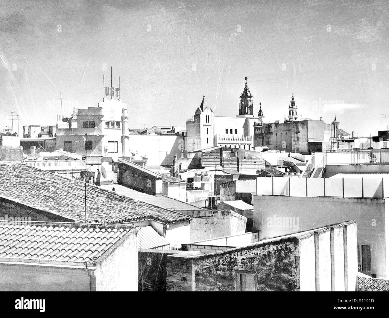 Spanish city filtered into an old time black and white photo - Stock Image