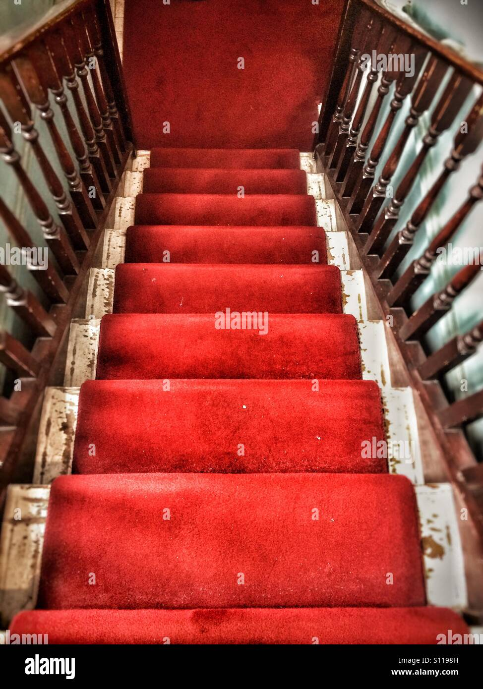 Looking down flight of stairs - Stock Image
