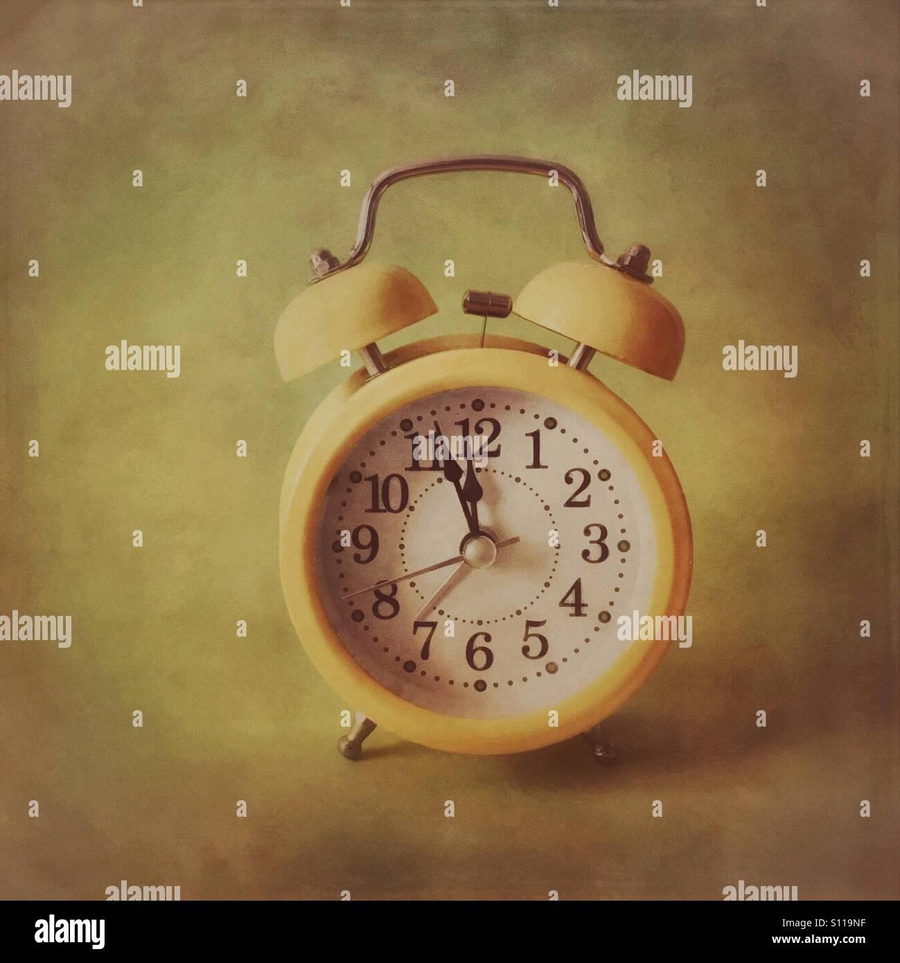 Retro alarm clock - three minutes to midnight - Stock Image