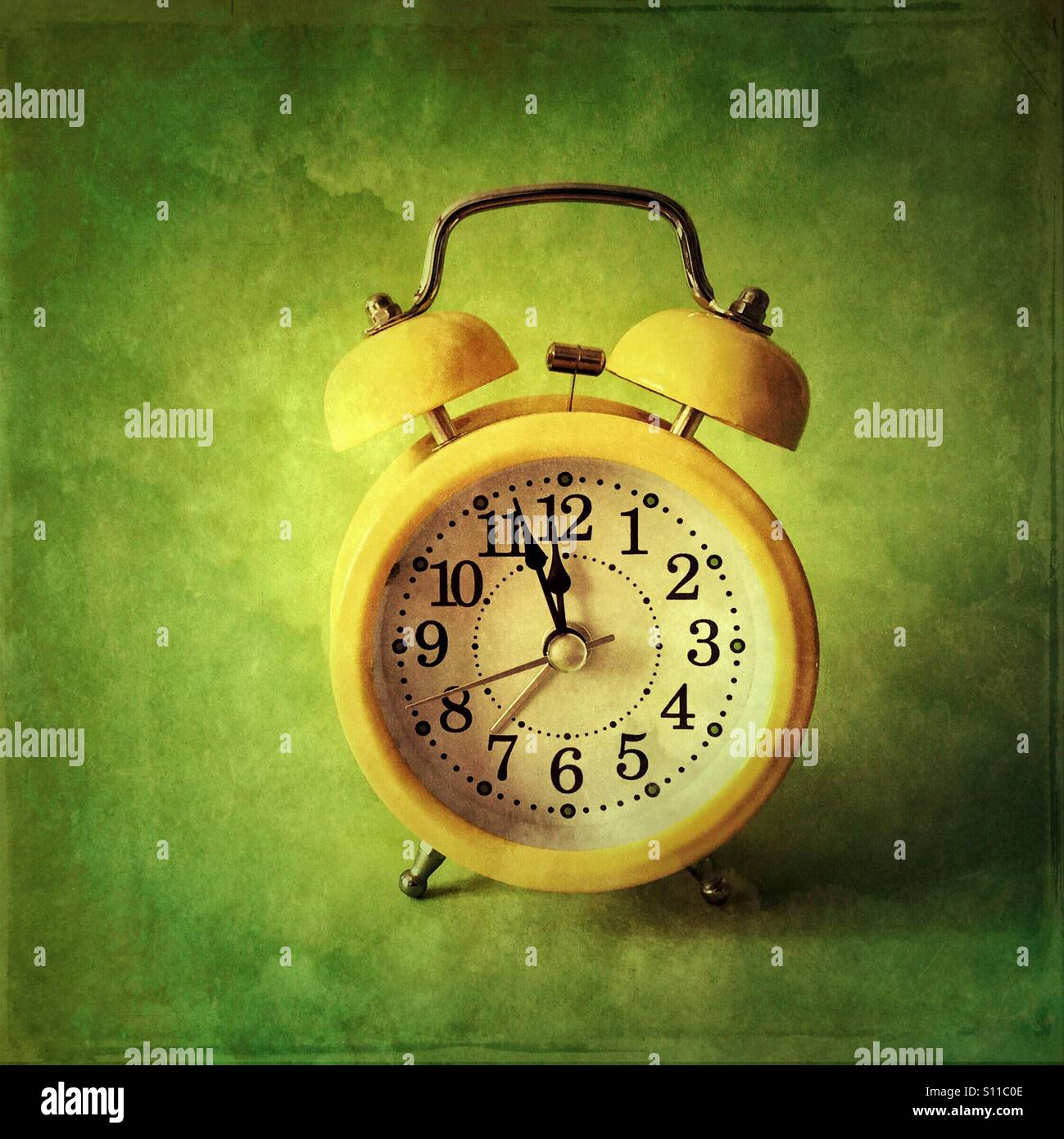 Retro alarm clock- three minutes to midnight - Stock Image