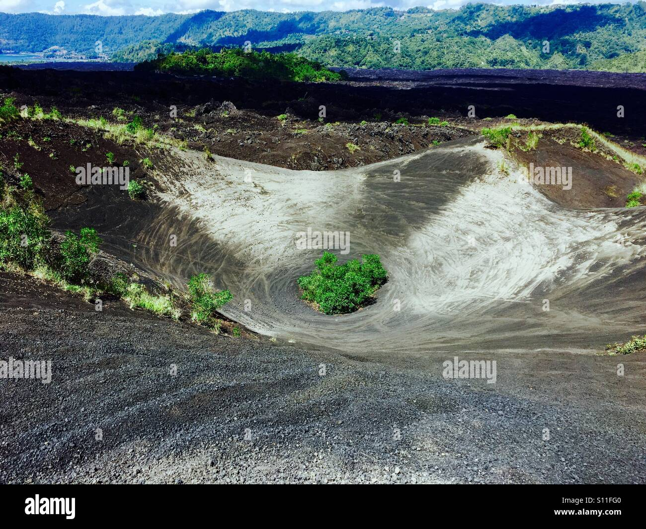 Old Volcanic vent turned into a modern day perpetual corner for dirt bikes. - Stock Image