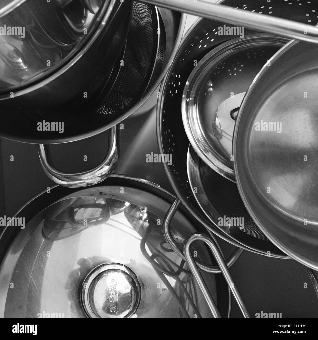 Collection of saucepans and kitchen utensils - Stock Image