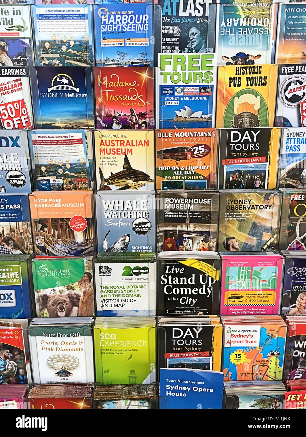 brochures and travel ads stock image
