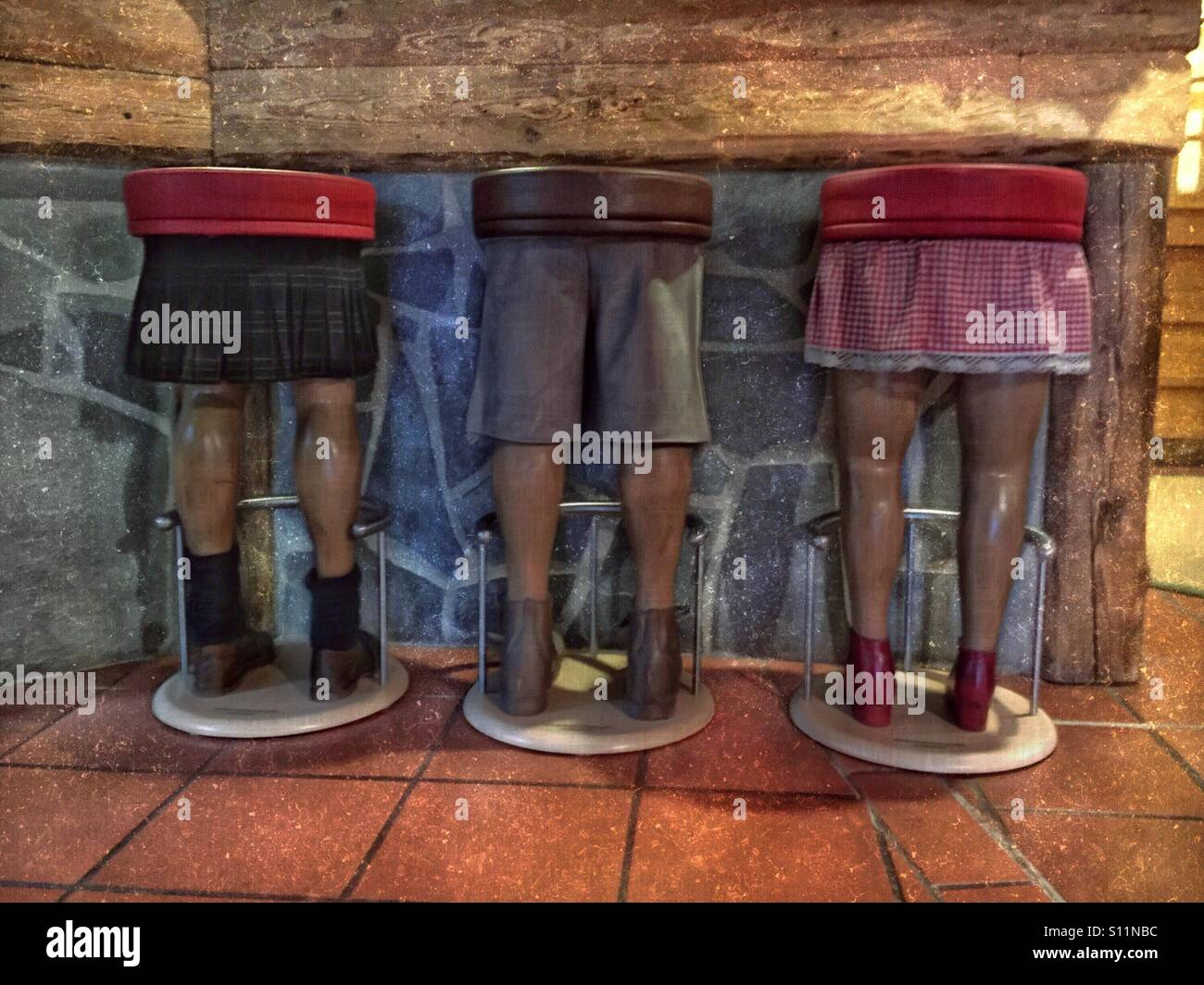 Funny Bar Stools In The Shape Of Human Legs Stock Photo