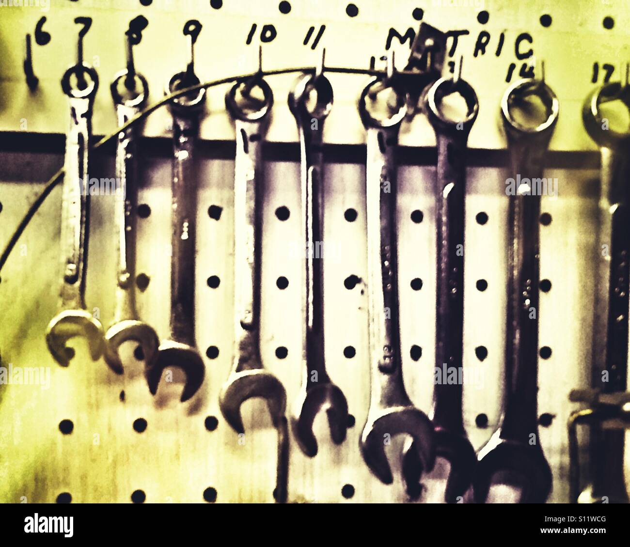 Wrenches on a pegboard - Stock Image