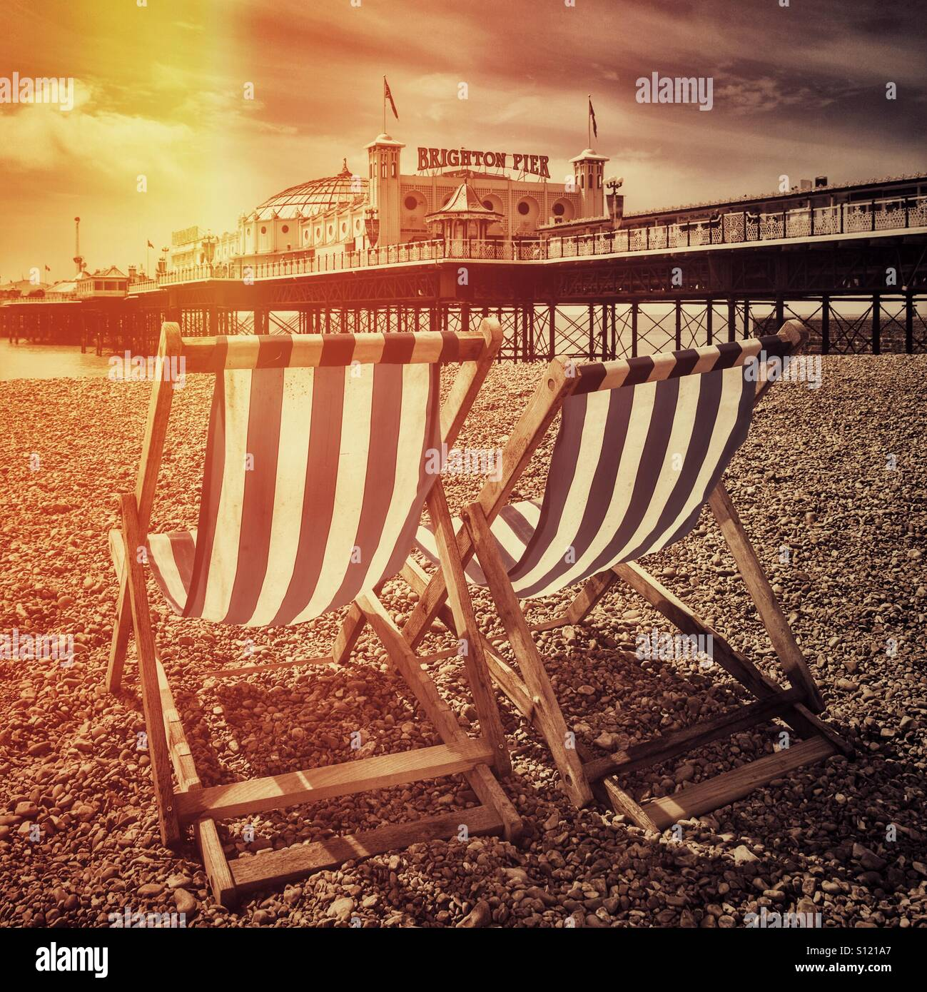 Deckchairs on brighton beach - Stock Image