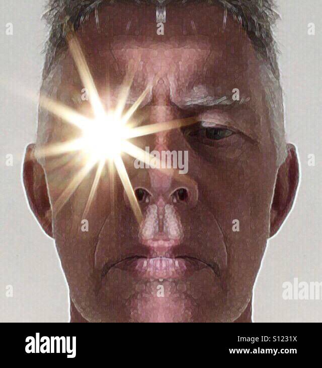 Symmetrical mans face with light from eye - Stock Image