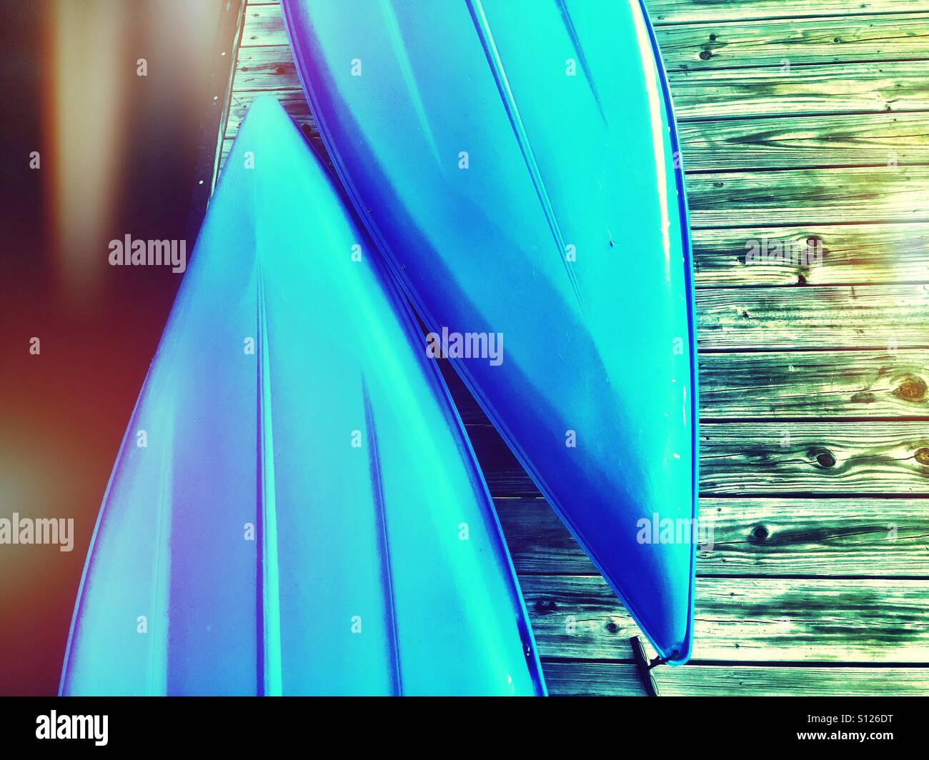 Two blue canoes - Stock Image