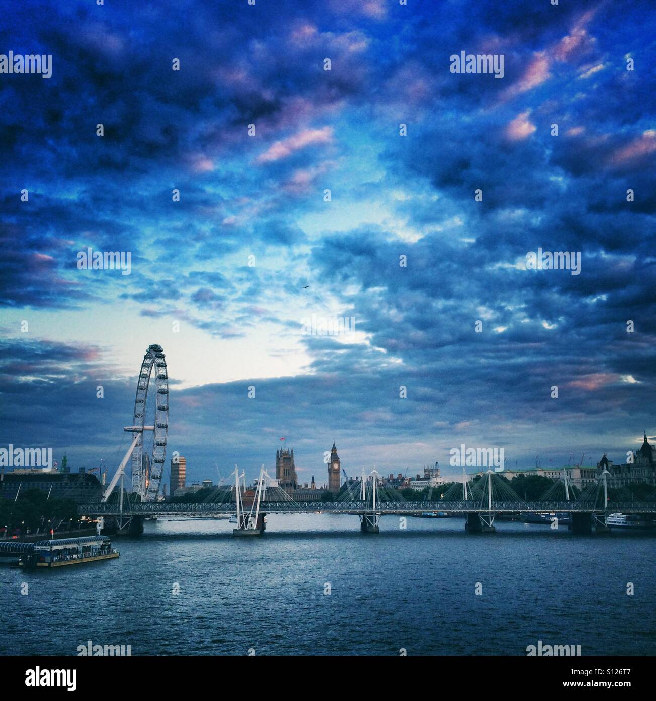 View of the Houses of Parliament and The London Eye from the Thames river, London - Stock Image