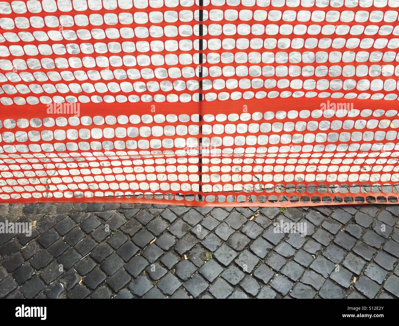Works in a cobblestone street - Stock Image