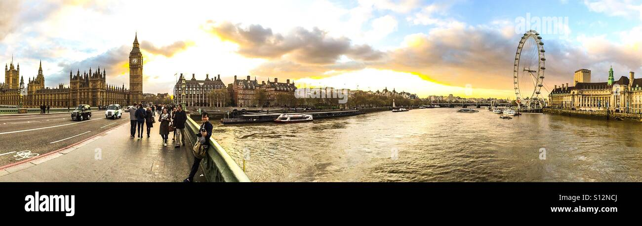 Sunset over London skyline from bridge over River Thames. - Stock Image