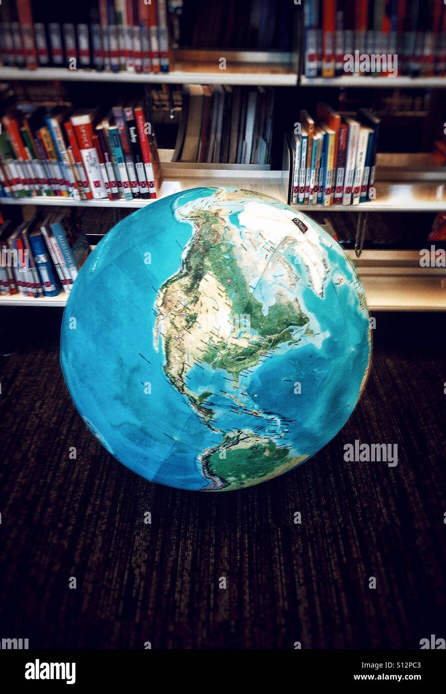 Globe bean bag in the library - Stock Image