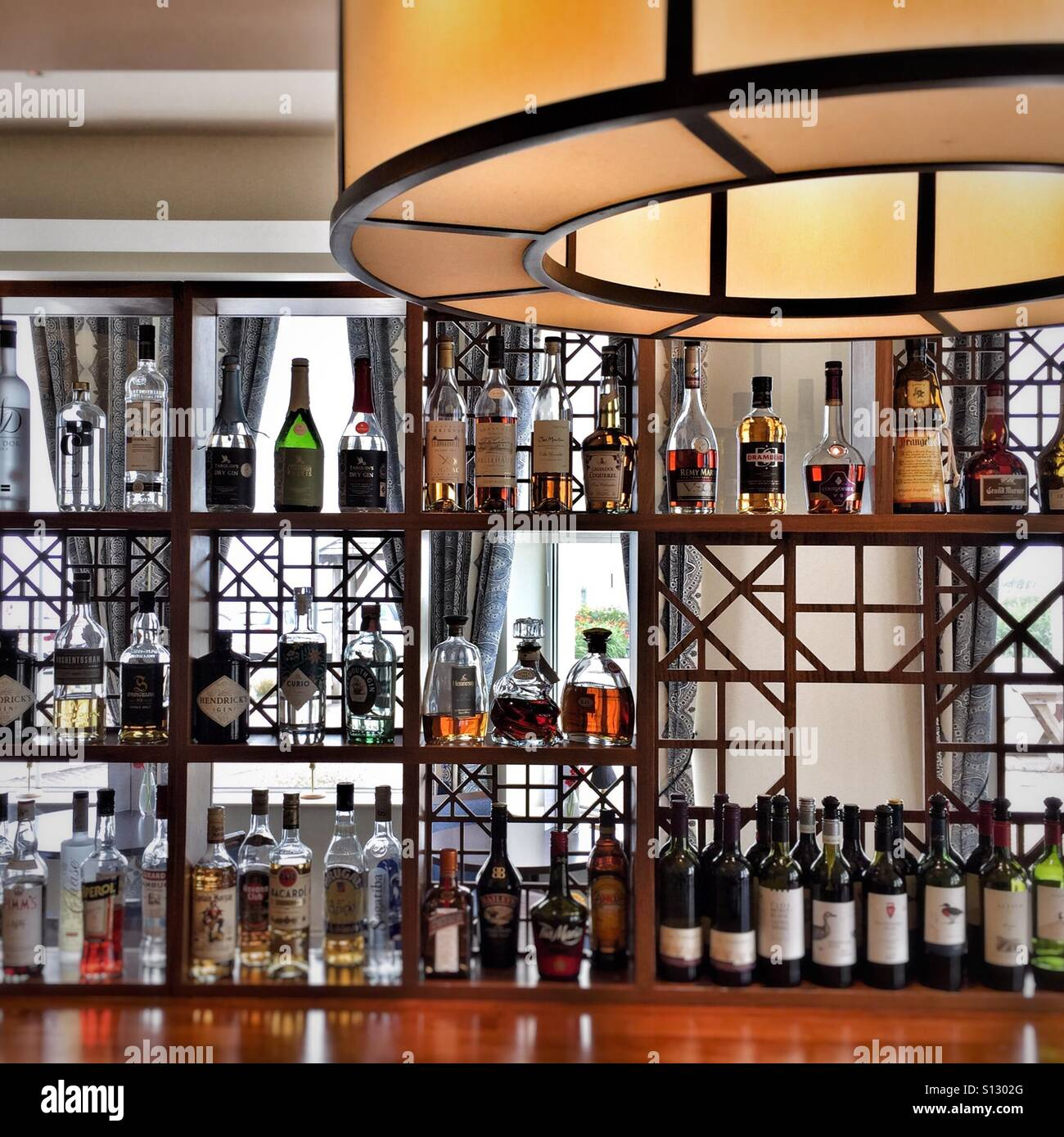 Well stocked bar in hotel, with spirit wall Stock Photo