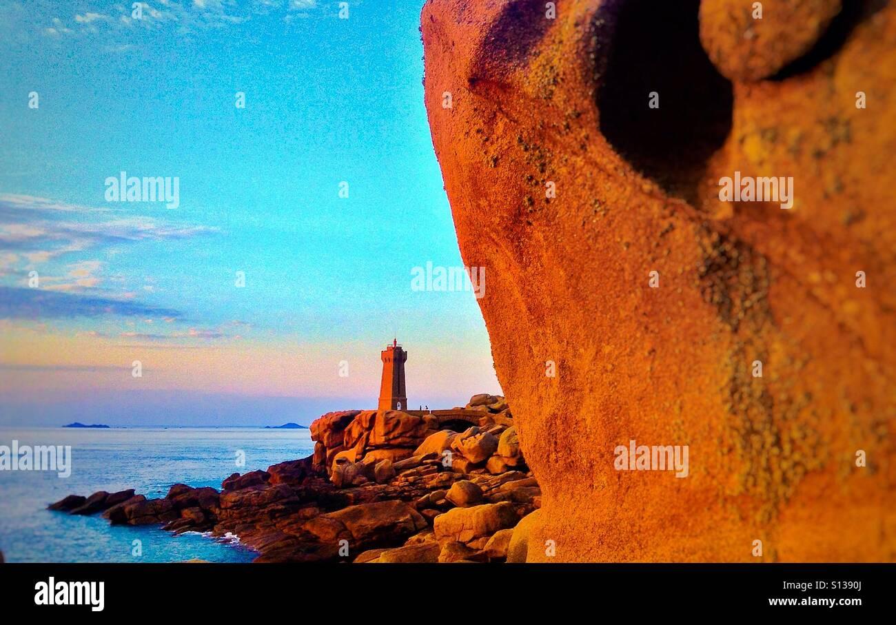 Point de Squewel and and Mean Ruz lighthouse, Men Ruz, Ploumanach, Cote de Granit Rose d'Armor, Bretagne, France,Stock Photo