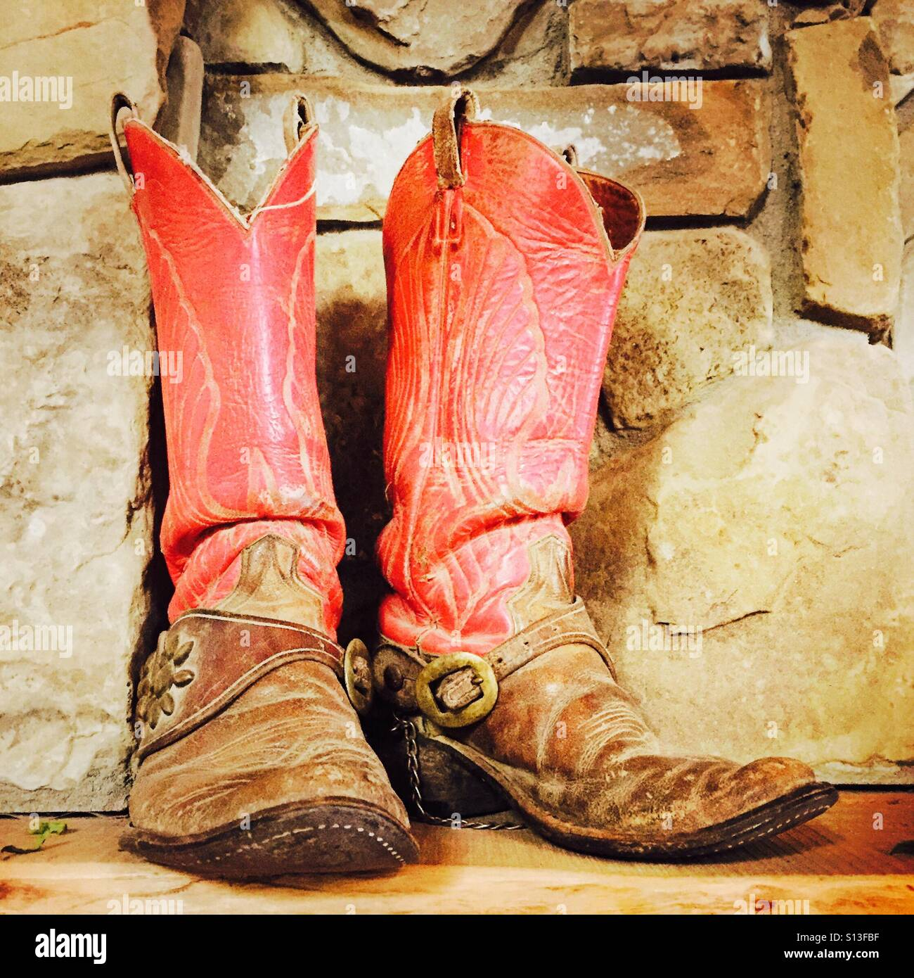 572bb9b8af8 An old worn out pair of cowboy boots Stock Photo: 310479219 - Alamy