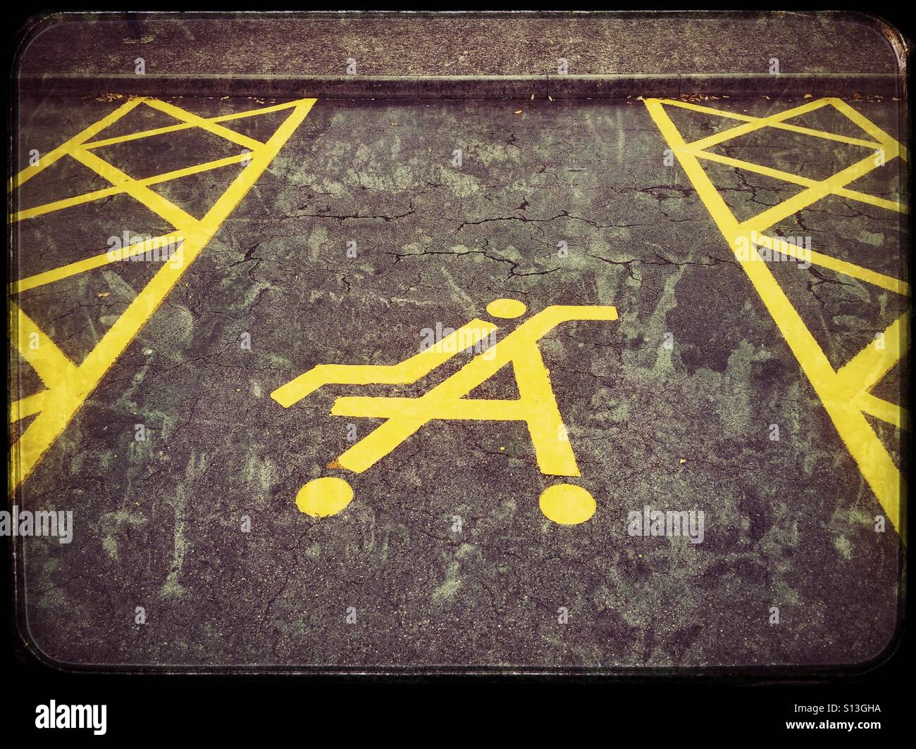 A parking space reserved for people who travel by car & transport children. The symbol of a child sitting in - Stock Image