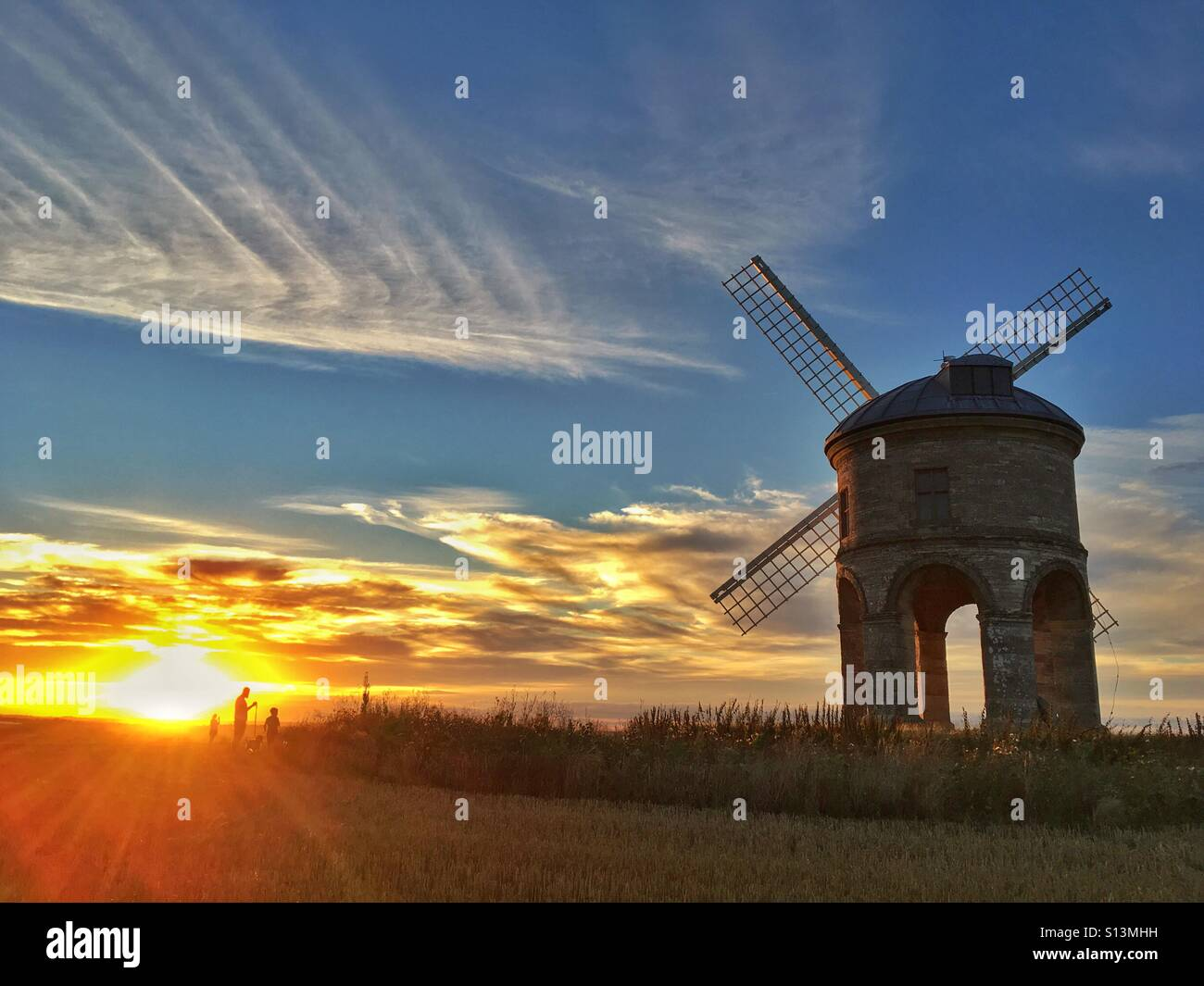 Windmill in sunset - Stock Image
