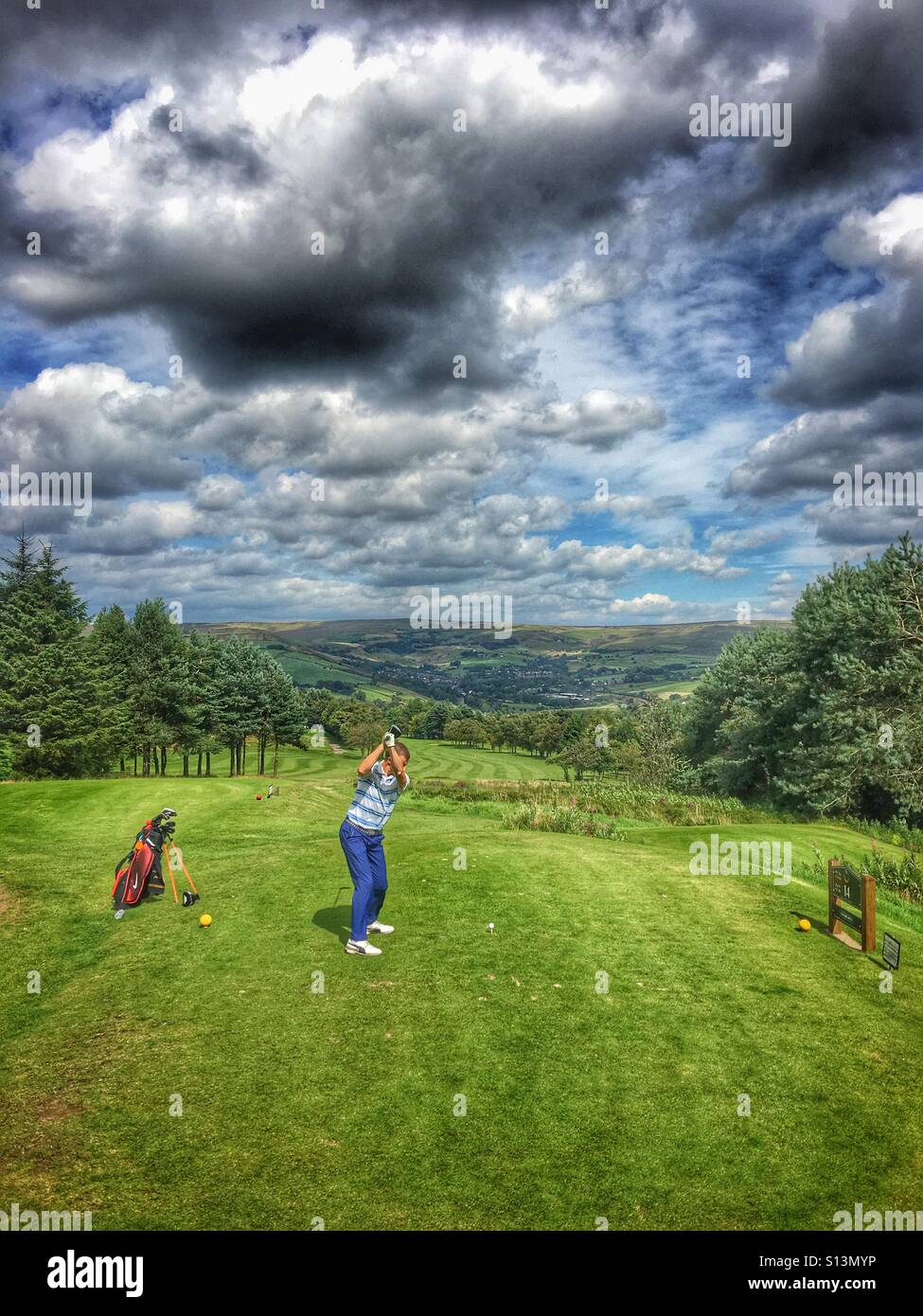 Top of the golf swing - Stock Image