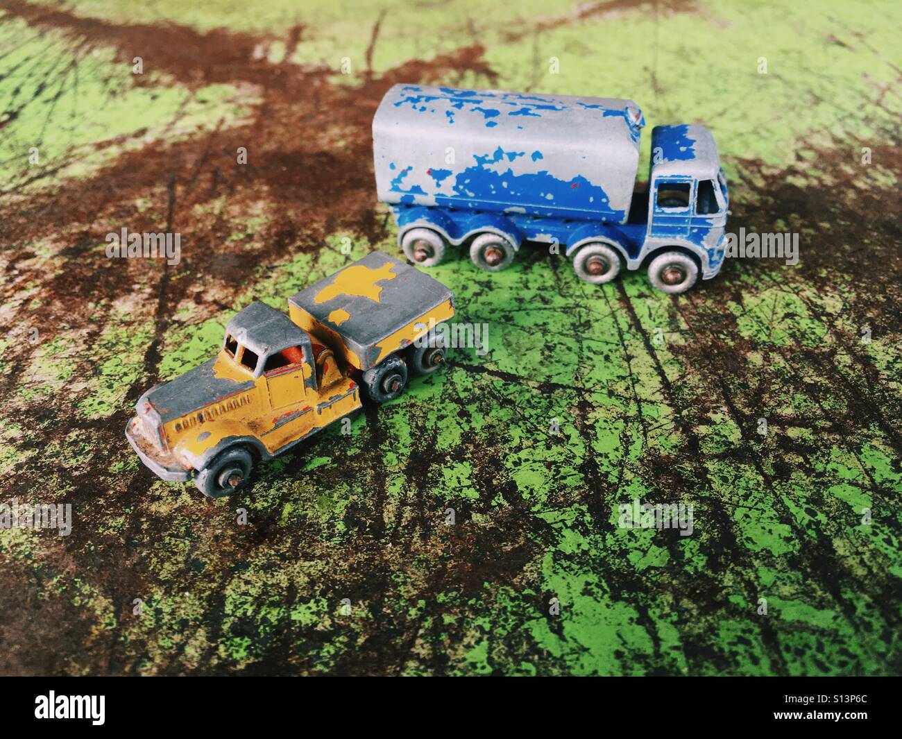 Vintage Matchbox cars on a grungy metal surface Stock Photo